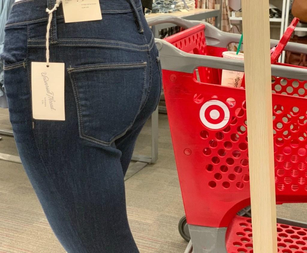 Women's Jeans in Target on display near cart in a dark wash