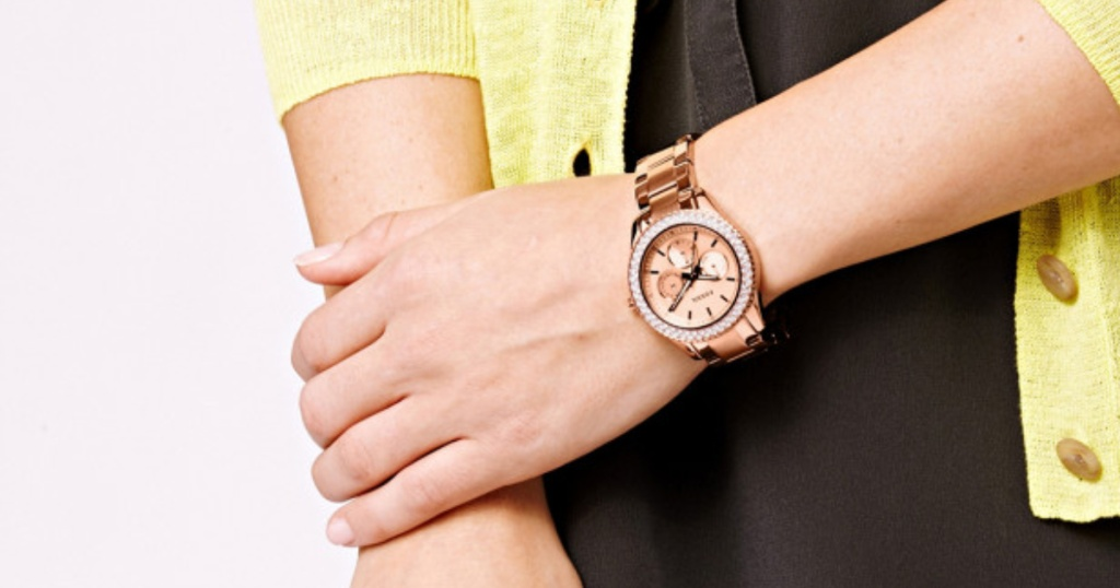 woman wearing rose gold fossil watch