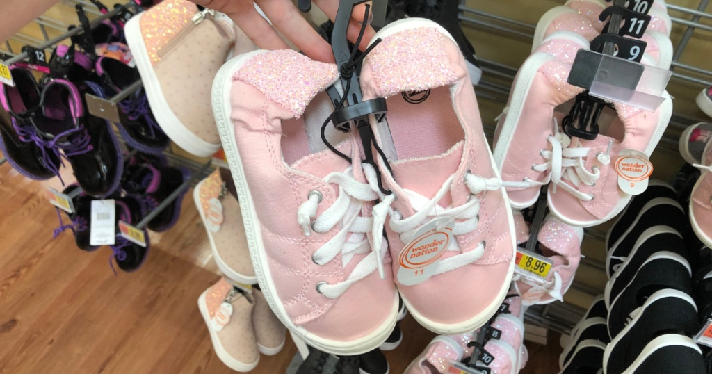 woman holding girls pink frost wonder nation shoes