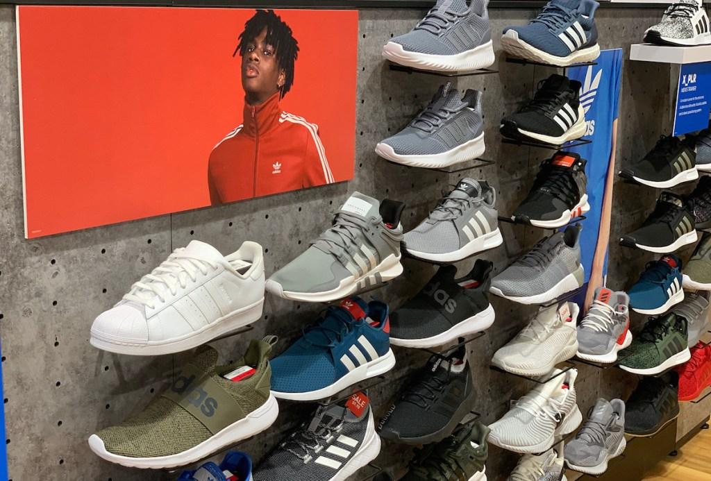 various types of adidas sneakers on display
