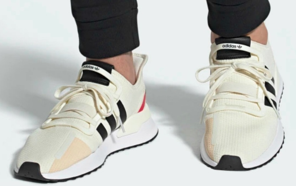 adidas brand running shoes in cream colored