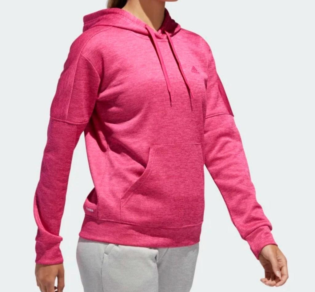 Woman wearing adidas hoodie in mangenta