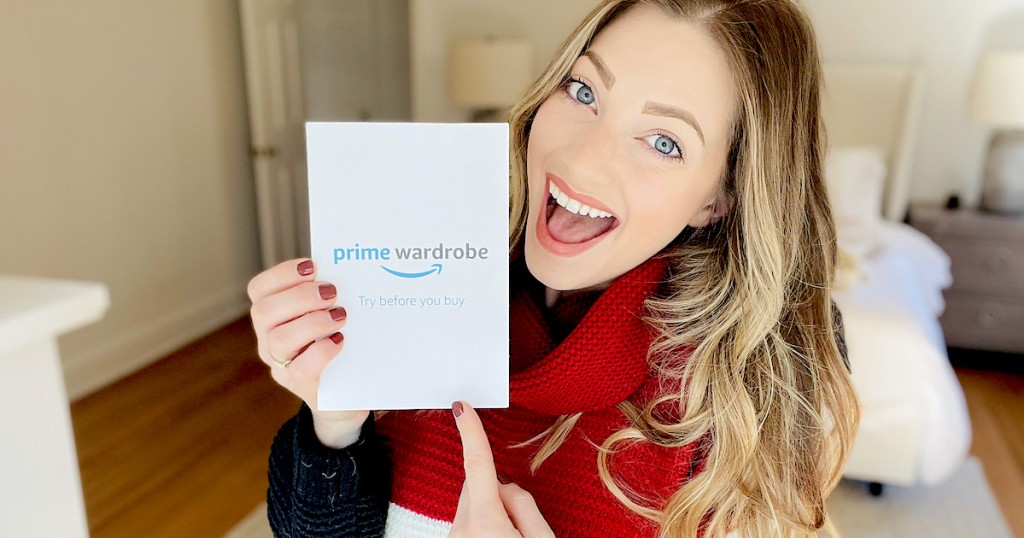 woman holding prime wardrobe packet