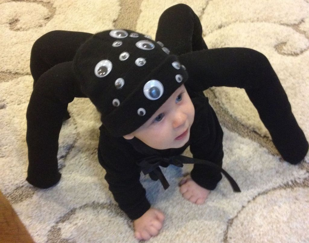 baby wearing black spider costume