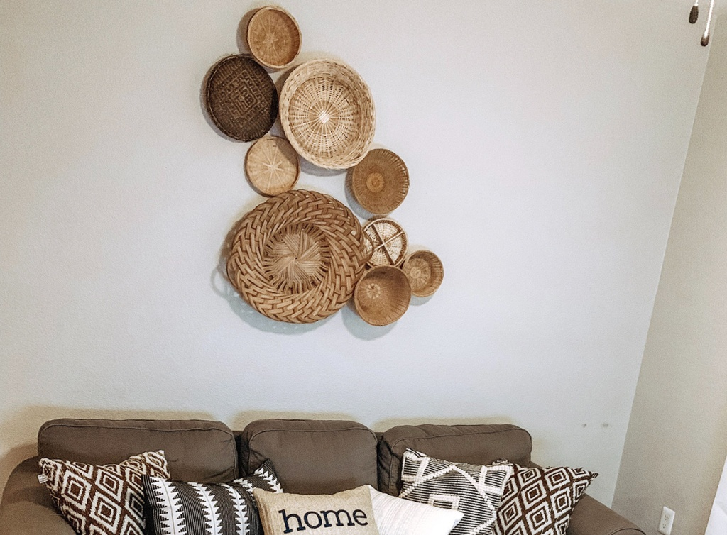 baskets arrange on wall over couch
