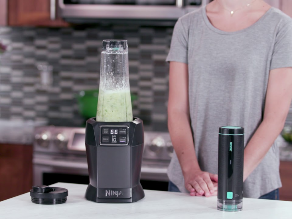 ninja blender with freshvac technology with woman counter