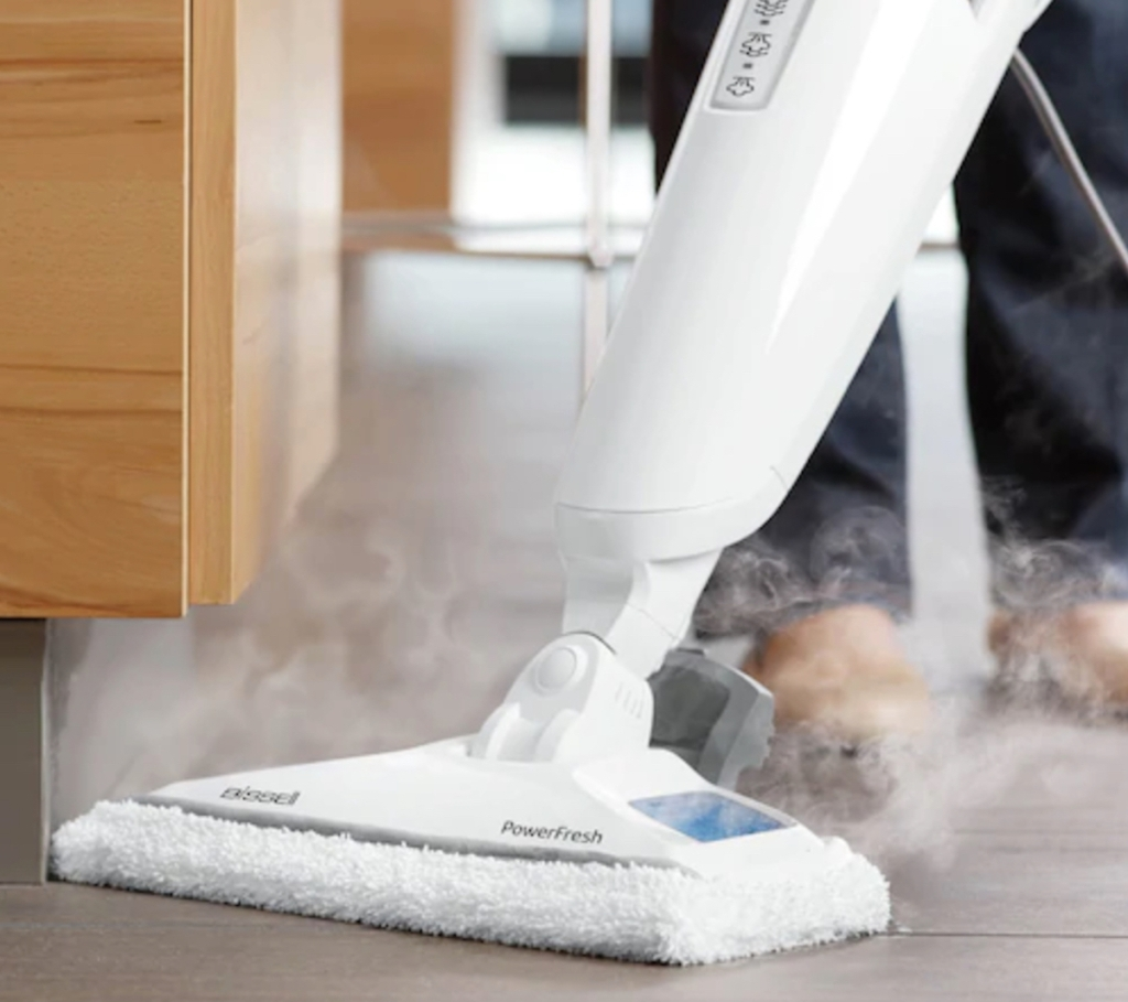 white steam mop cleaning and steaming floor