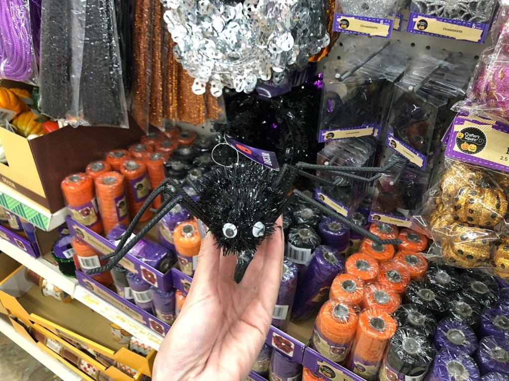 hand holding black tinsel spider