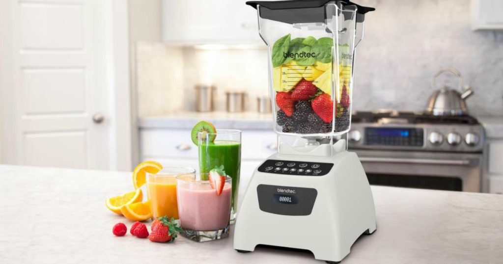 white blendtec wildside blender on counter next to smoothies