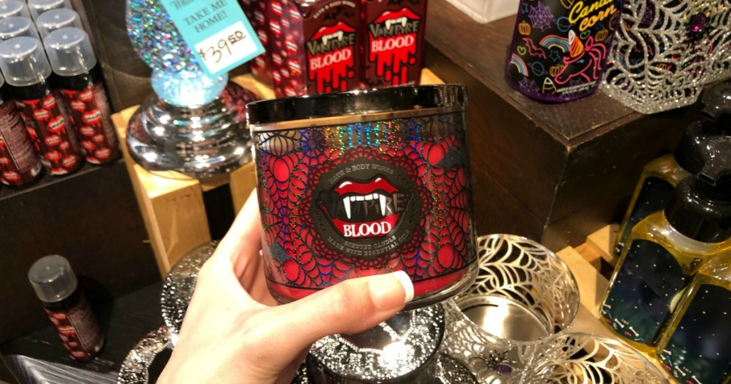 hand holding blood candle