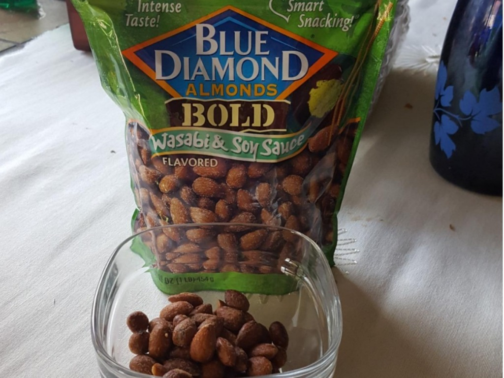 blue diamond bold almonds with wasabi soy sauce bag and some almonds in glass bowl