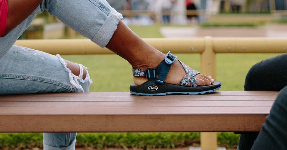 womens leg up on bench with sandal