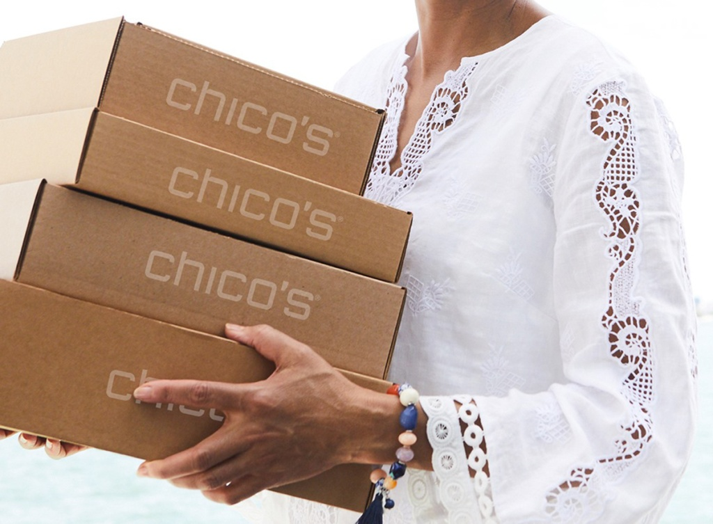 woman carrying Chico's boxes