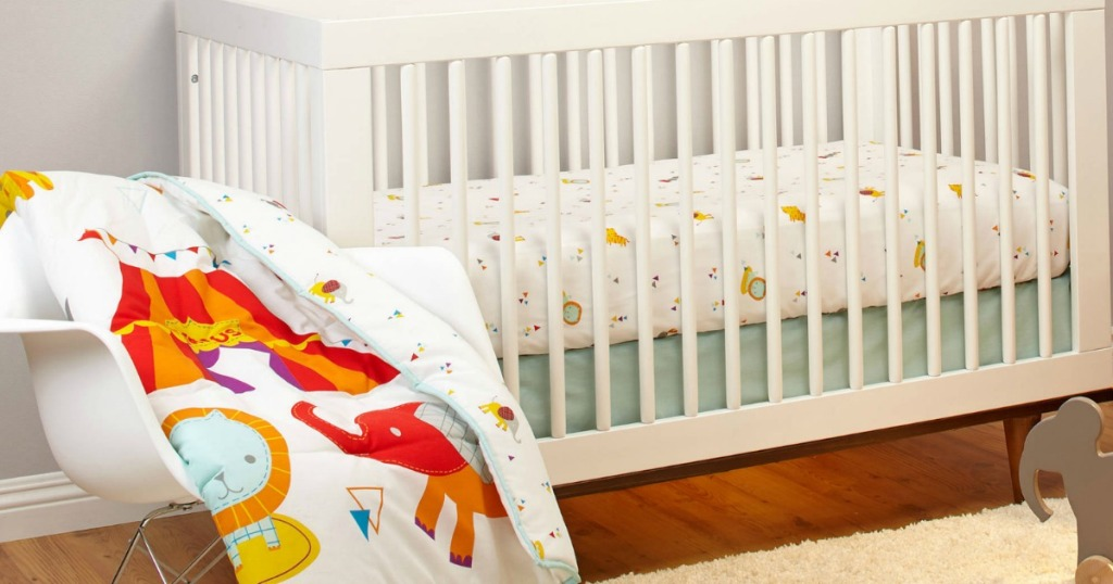 white nursery furniture with circus bedding
