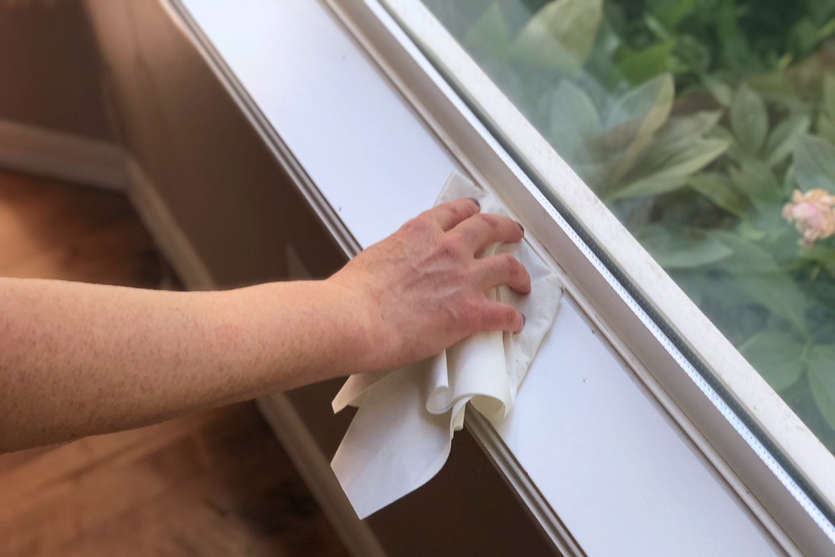 cleaning ledge of window sill with zap cloth