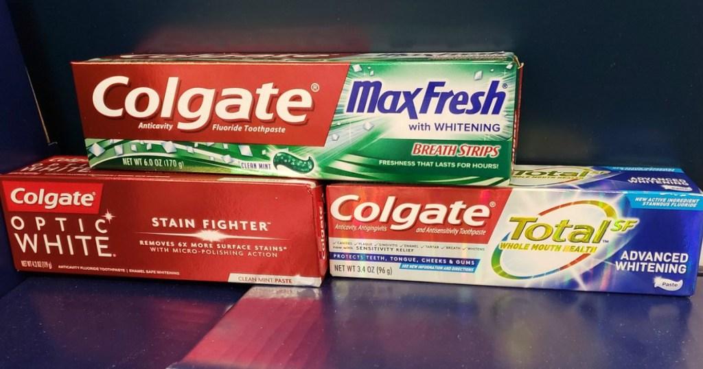 three tubes of colgate toothpaste