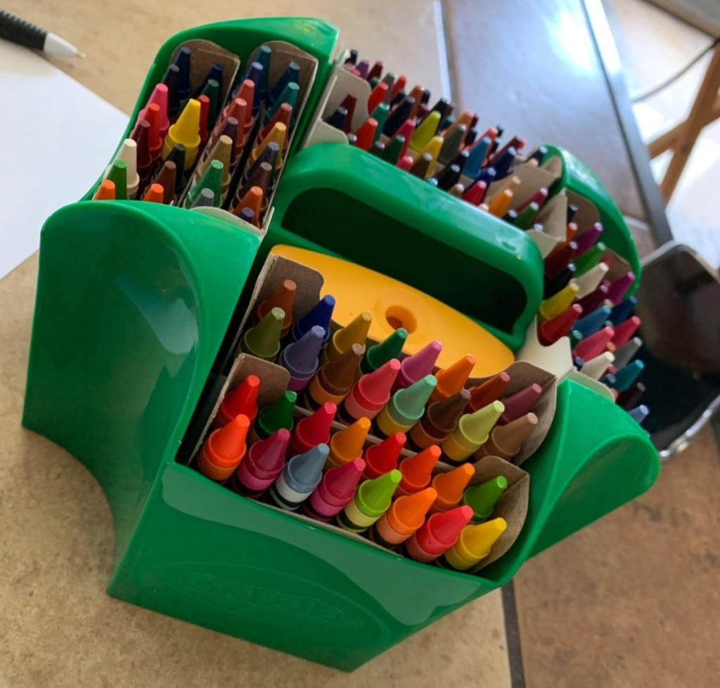 green caddy holding crayons