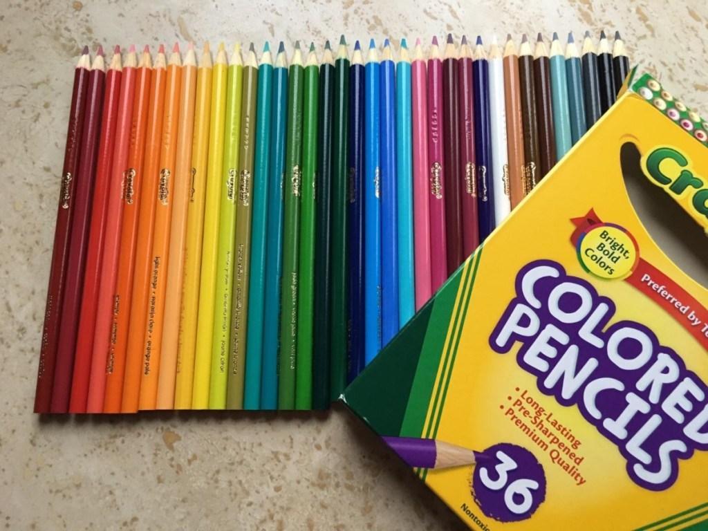 crayola colored pencils next to box