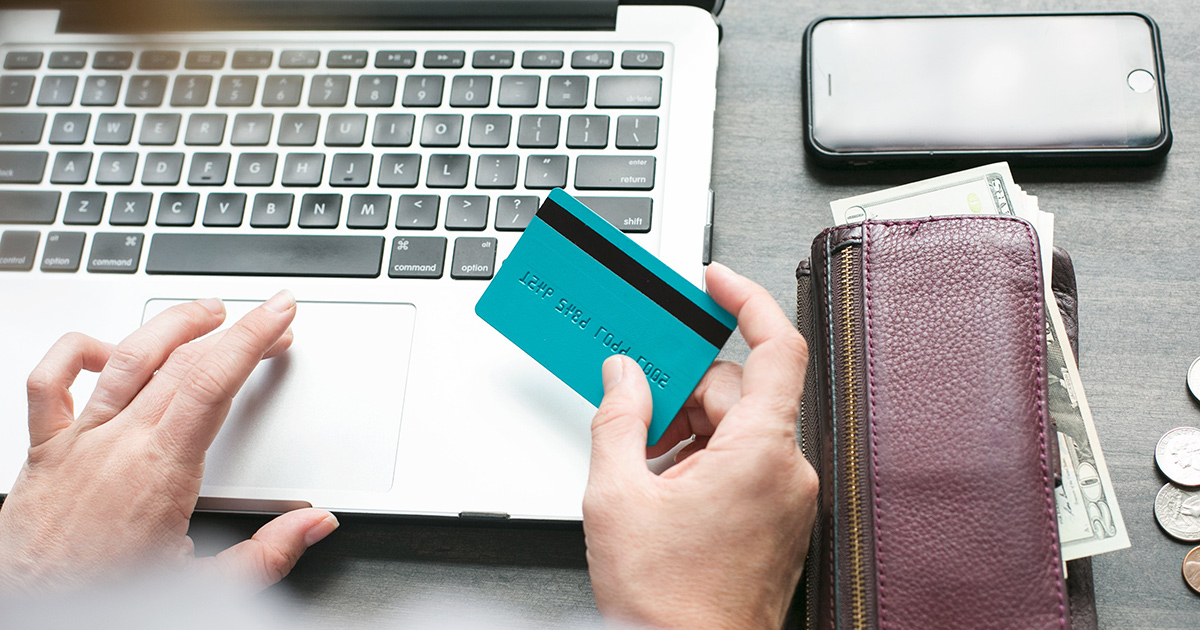 person at computer with credit card