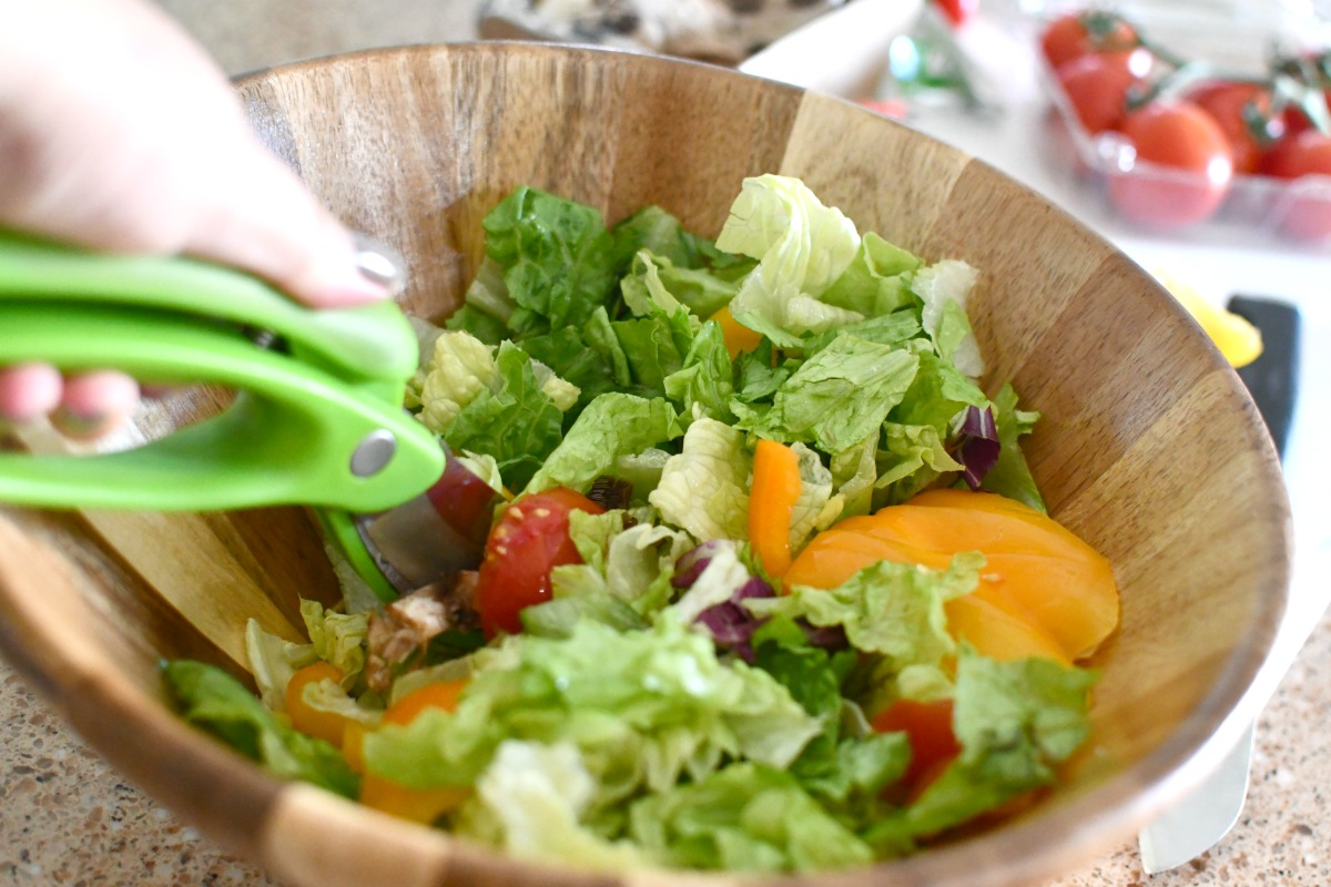 cutting salad right in the bowl with toss and chop scissors