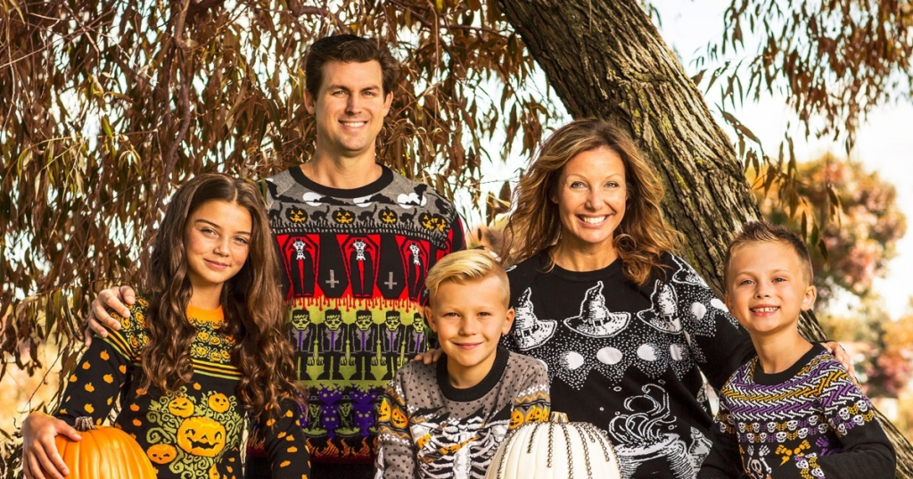 family wearing ugly Halloween sweaters