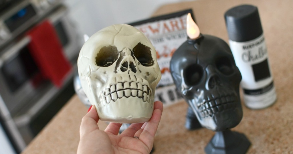 holding a dollar tree skull candlestick