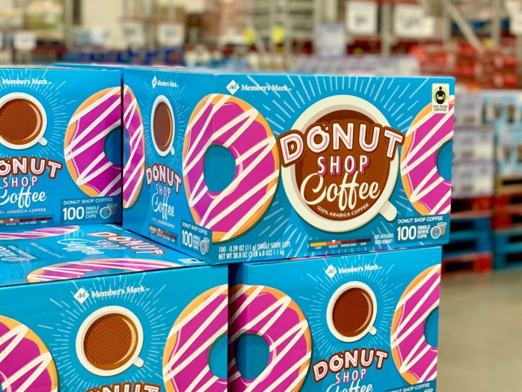 boxes of coffee in store with donut pictures on them