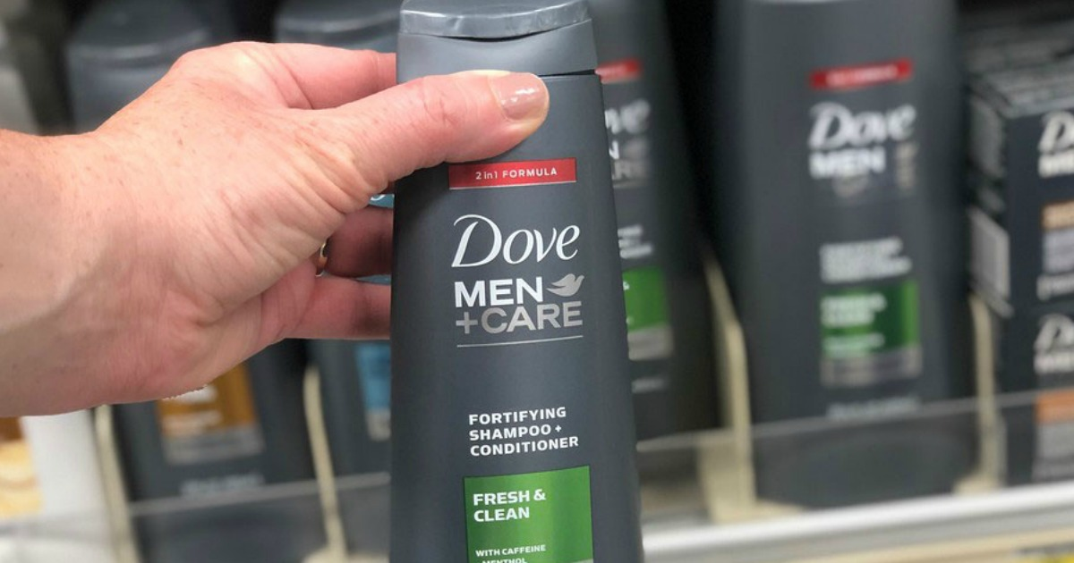 dove men+care shampoo and conditioner held in store