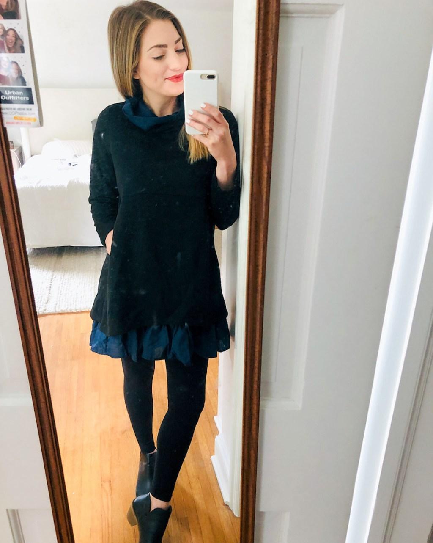 woman wearing black amazon dress taking selfie in mirror