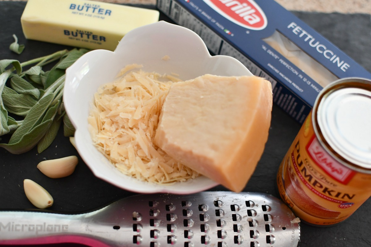 easy pumpkin alfredo ingredients on a cutting board
