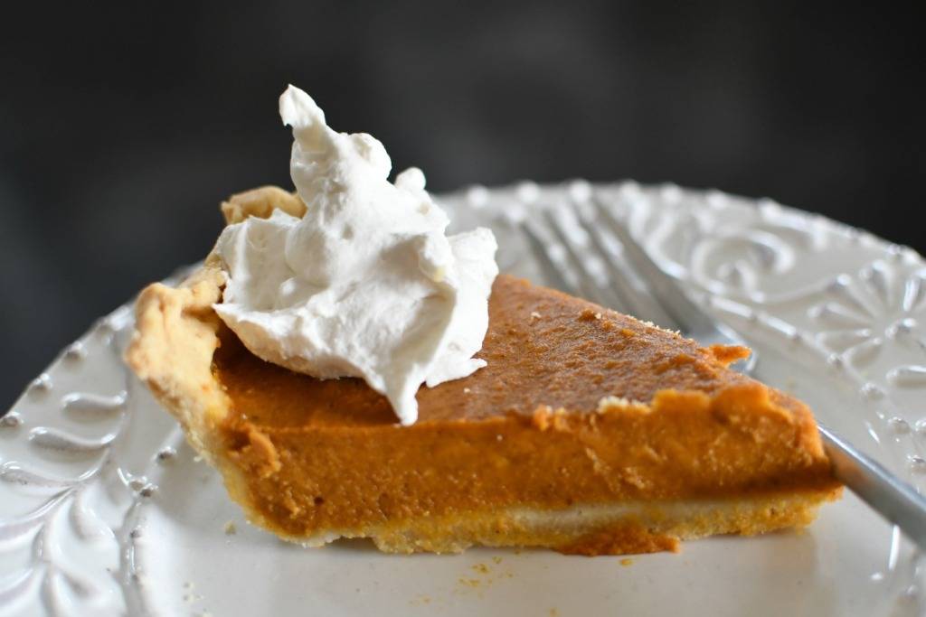 slice of vegan pumpkin pie with vegan tru whip