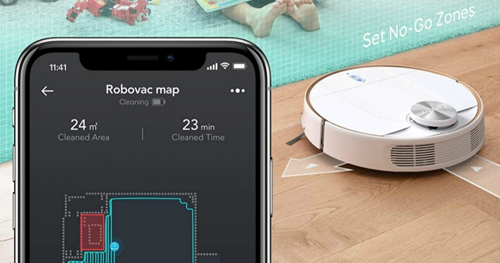 smartphone next to robotic vacuum
