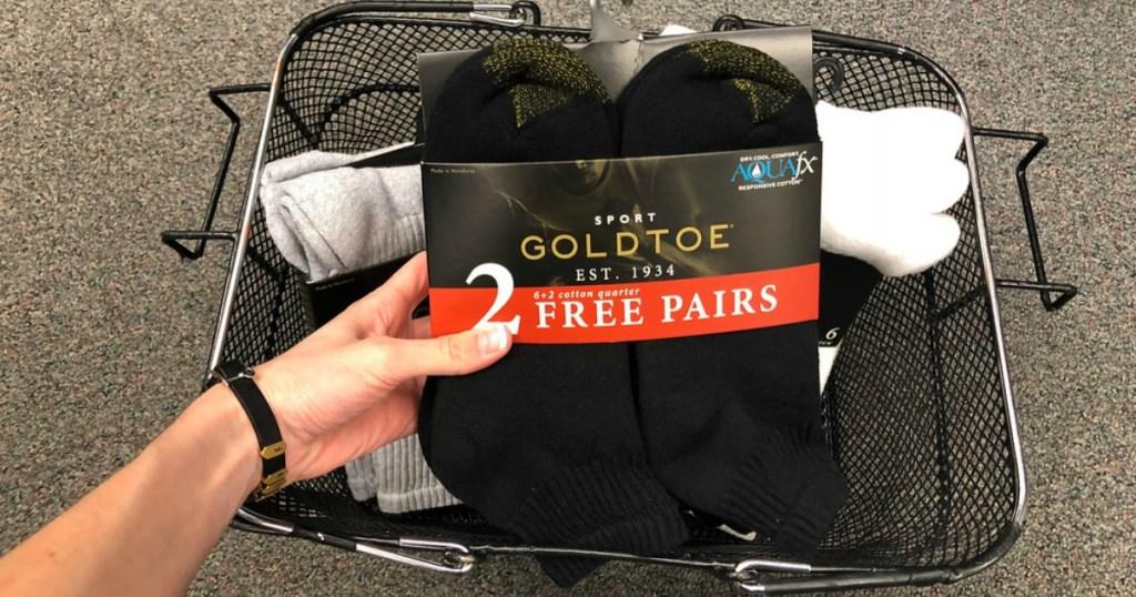 hand holding gold toe socks
