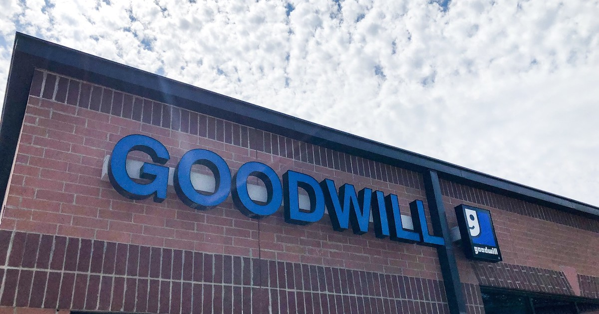 blue goodwill sign on store front outside