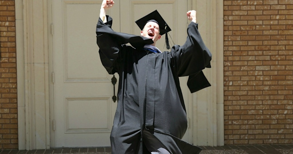 College graduate showing excitement