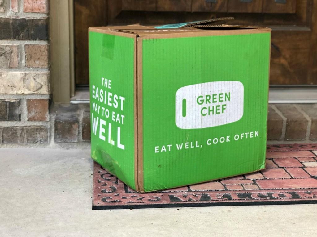 green cardboard box on porch
