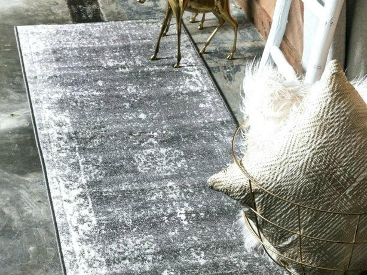 grey runner rug on hard floor