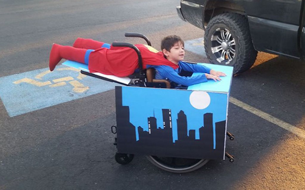 boy in superman wheelchair costume