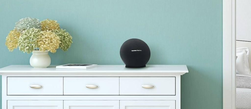 HarmanKardon brand bluetooth speaker on dresser