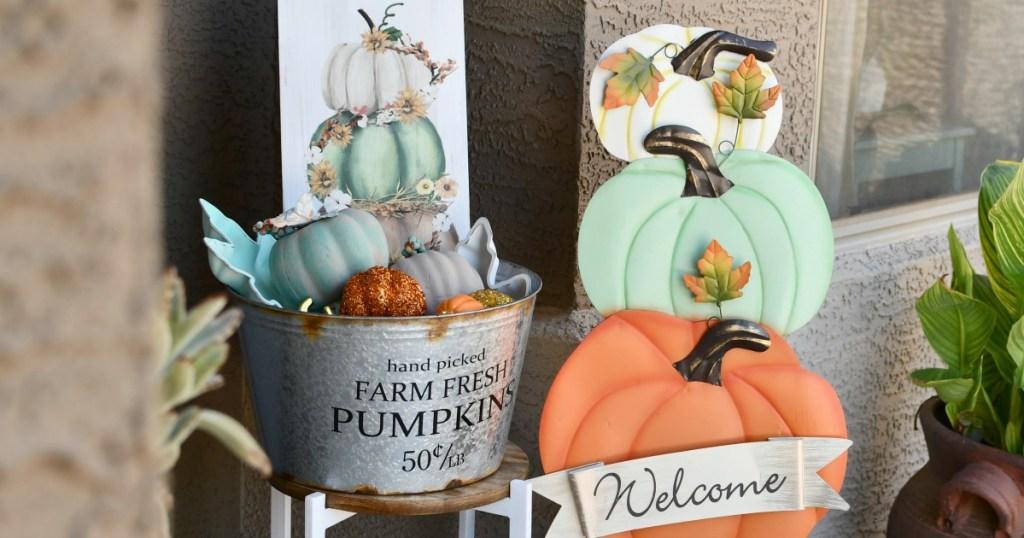 pumpkin decor on front porch