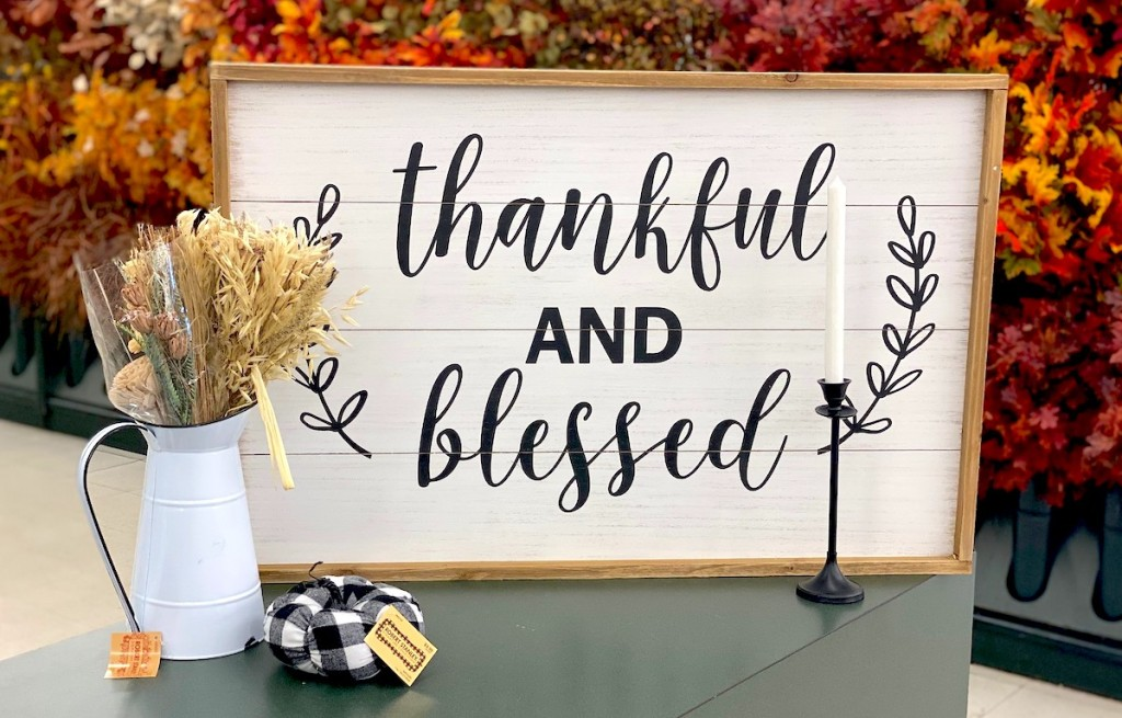 thankful and blessed sign in store with various fall decor