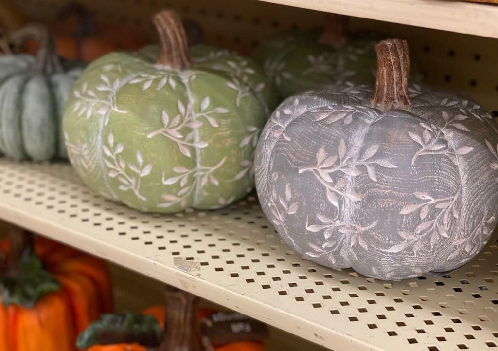 green and gray pumpkins on store shelf