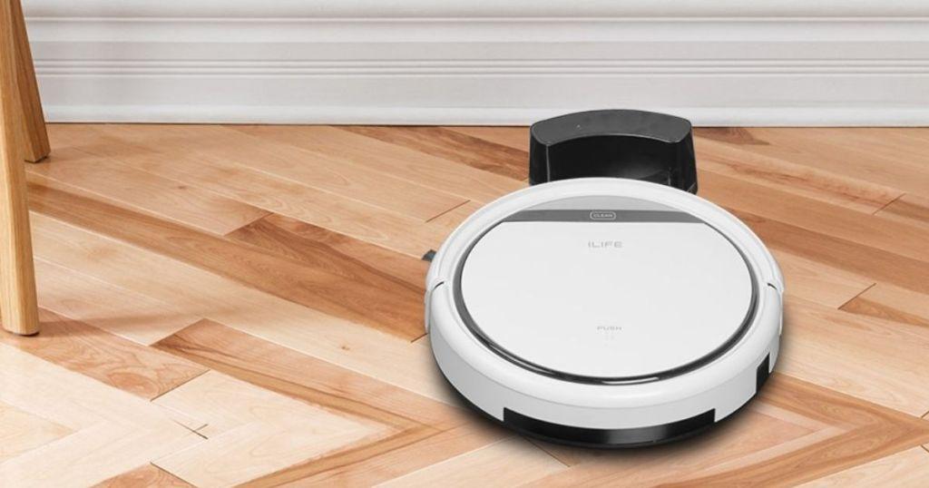 ilife v3 vacuum on hardwood floor on charger