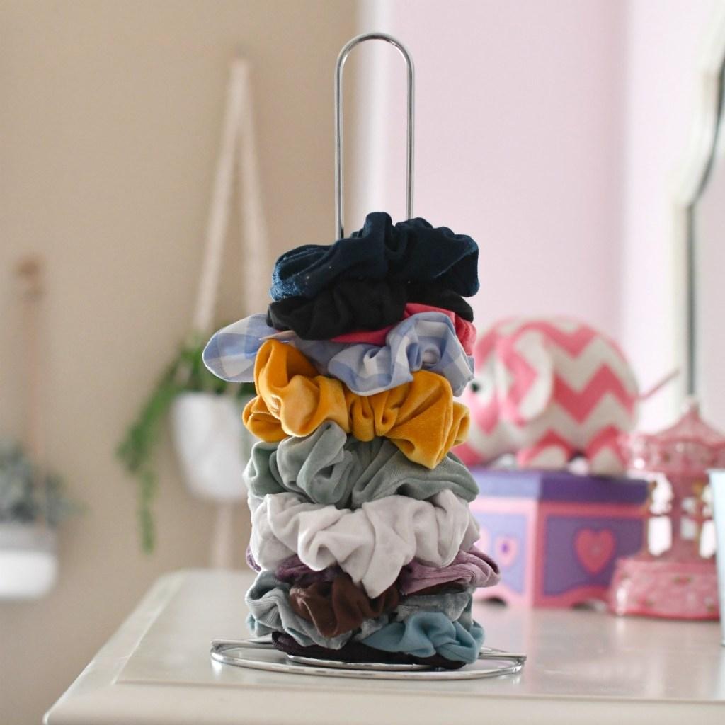 dollar tree paper towel holder as a scrunchie organizer