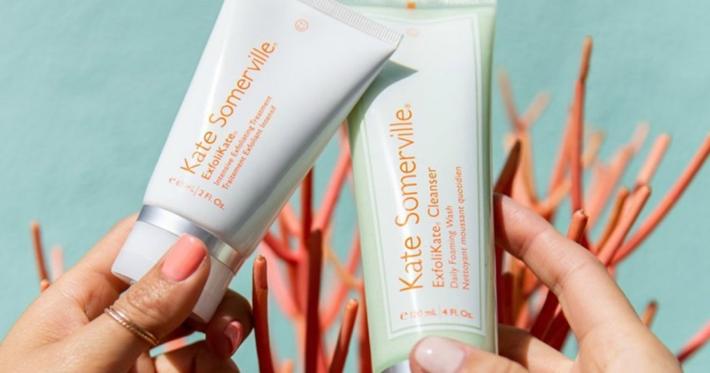 hands holding up kate somerville products