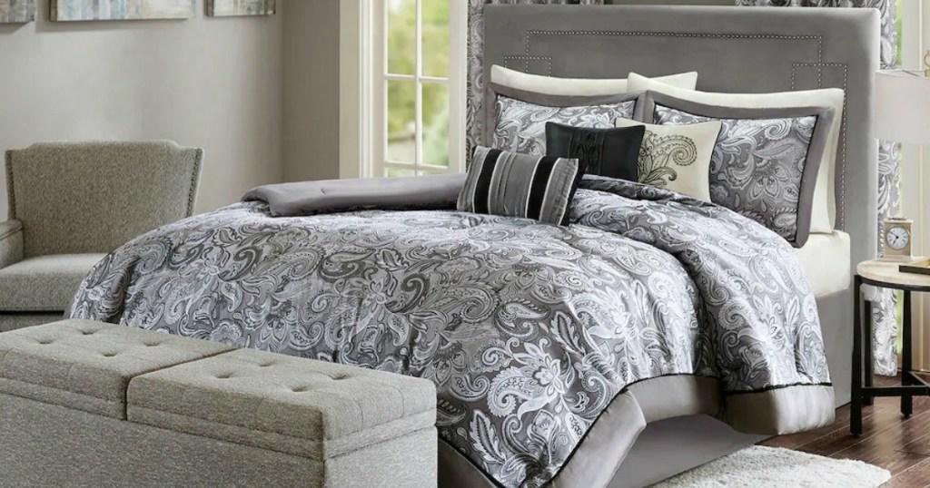Gray paisley print comforter set on bed