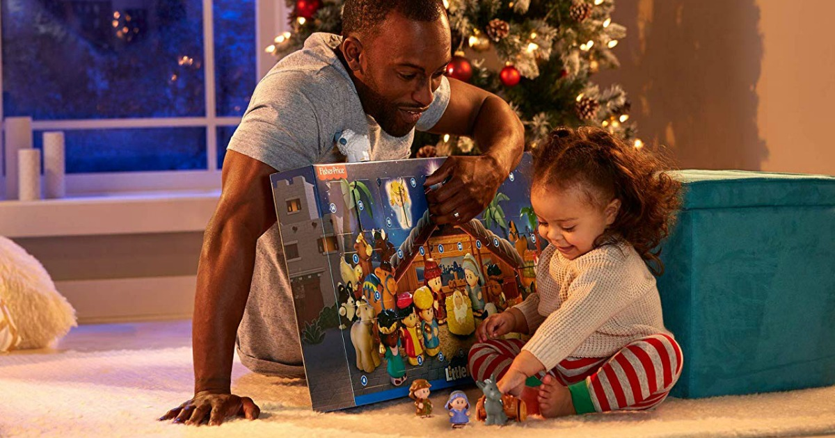 dad and daughter opening Little People advent calendar