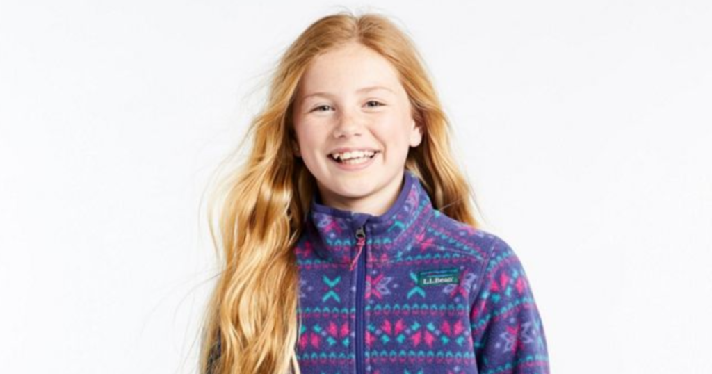 girl laughing with llbean jacket on