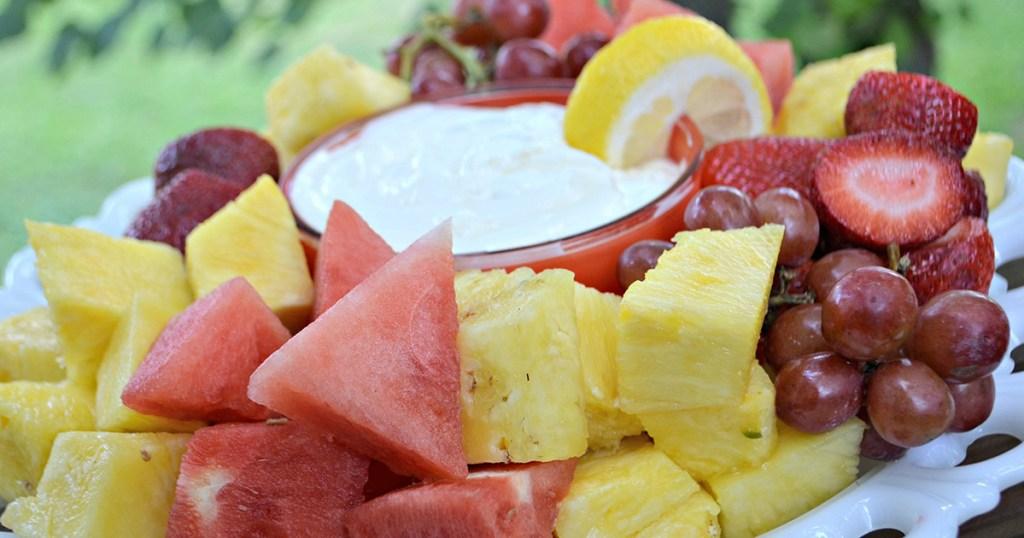 platter of fruit around fruit dip