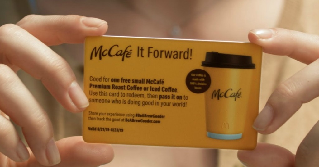 hand holding up maccafe it forward card